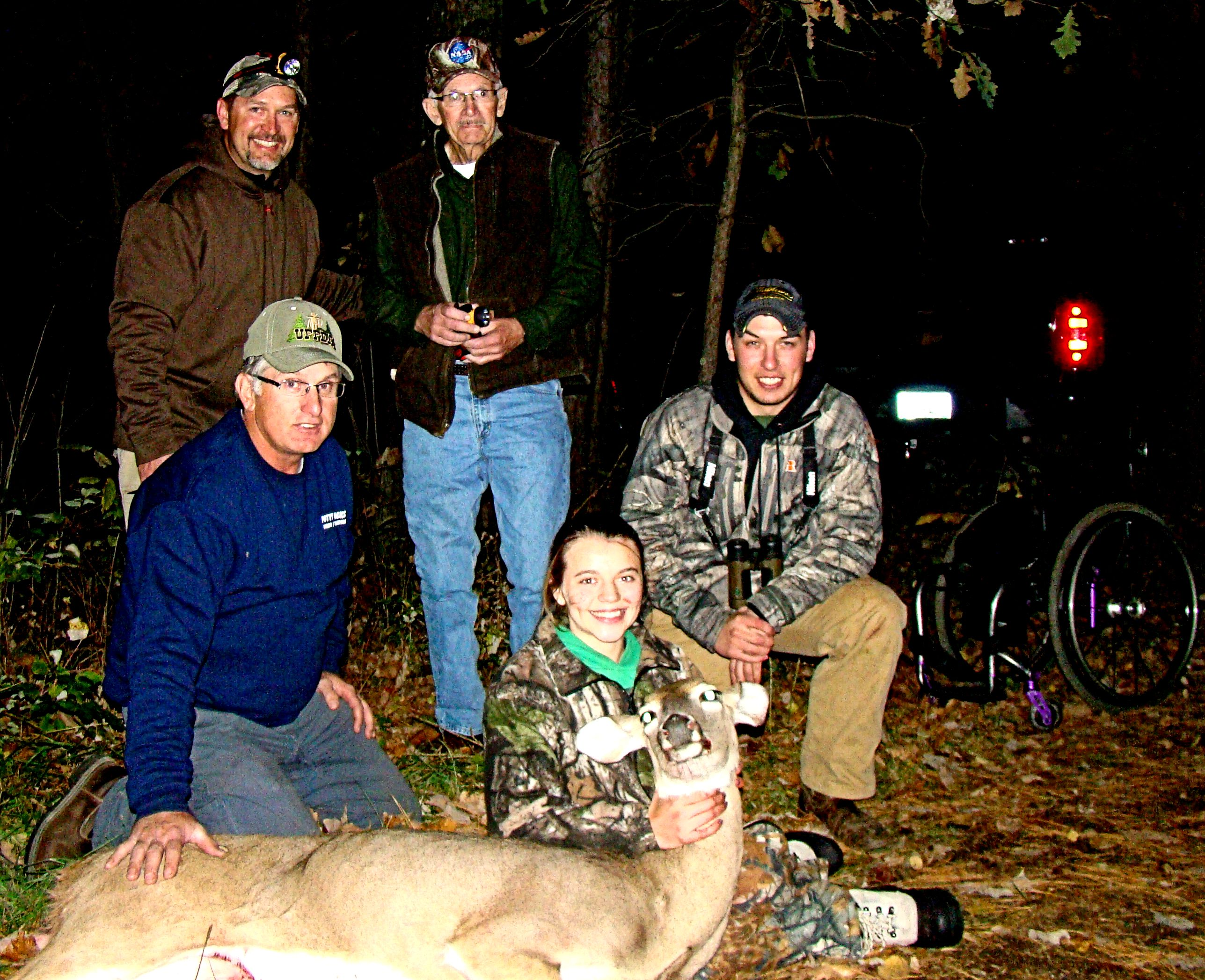 Brynn Duncan surrounded by (l to r) Richard Swenson on ground, Kelly, Dean and Kody Craft (3-generations of excellence).